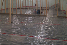 Vapor barrier applied to basement floor